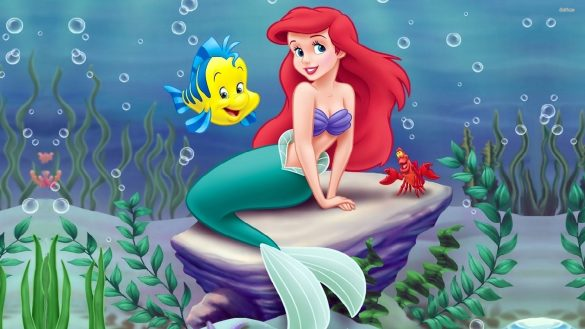 Cover art for The Little Mermaid - Ariel is sat on a rock as Flounder floats beside her