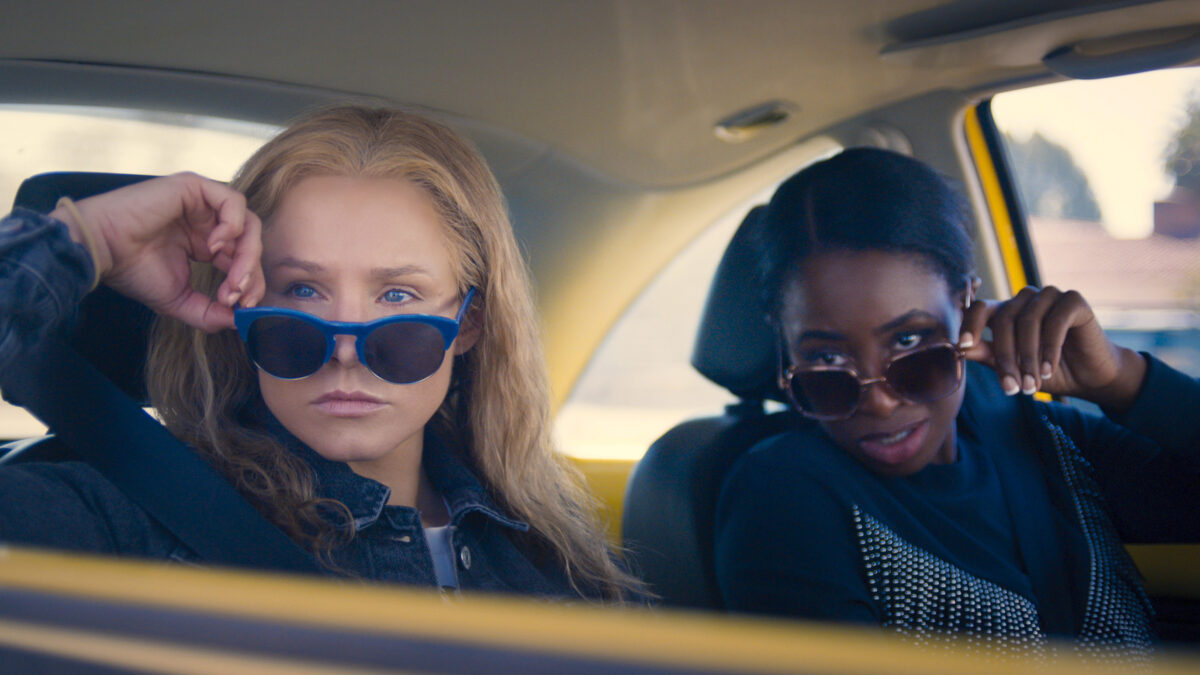 Kristen Bell & Kirby Howell-Baptiste Are The Robin Hood Of Coupons In New 'Queenpins' Trailer